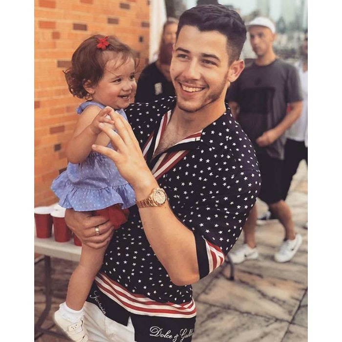 """As you can see this little angel makes me very happy,"" Nick Jonas wrote on his Instagram along with this adorable shot. ""Happy Fourth of July everyone. I hope you've had a great day with the ones you love.""