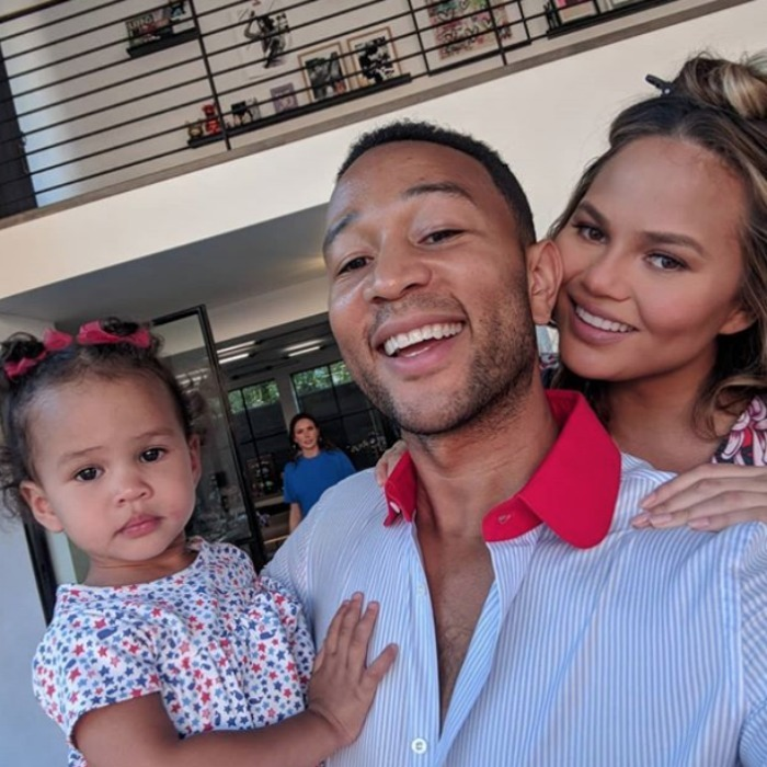 Holiday trio! John Legend, Chrissy Teigen and their little girl Luna posed in red, white and blue ensembles during their 'legendary' celebration.
