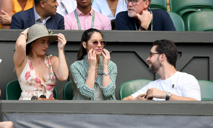 Caption this! Cara McConnell and Olivia Munn joined Serena William's husband Alexis to cheer her on during day five of Wimbledon on July 6. 