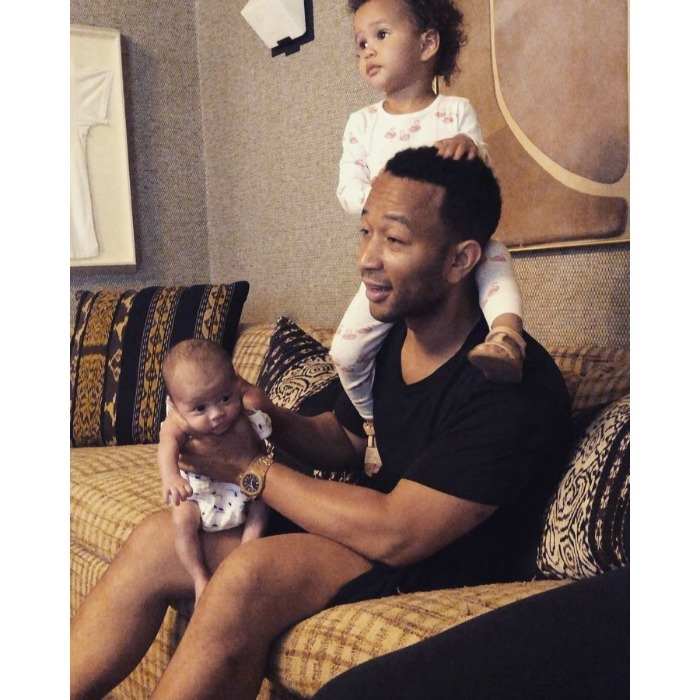 "Life with the Legends! Chrissy Teigen took to Instagram to share a <b><a href=""https://www.instagram.com/p/Bk6T6dHnjWv/?taken-by=chrissyteigen"">hilariously sweet video</a></b> of her husband John Legend spending time with their two kids on Friday, July 6. The singer sat on the couch burping their newborn son Miles, while their 2-year-old daughter Luna sat on his shoulders and grabbed at his face. John was all smiles, clearly loving life as a dad!