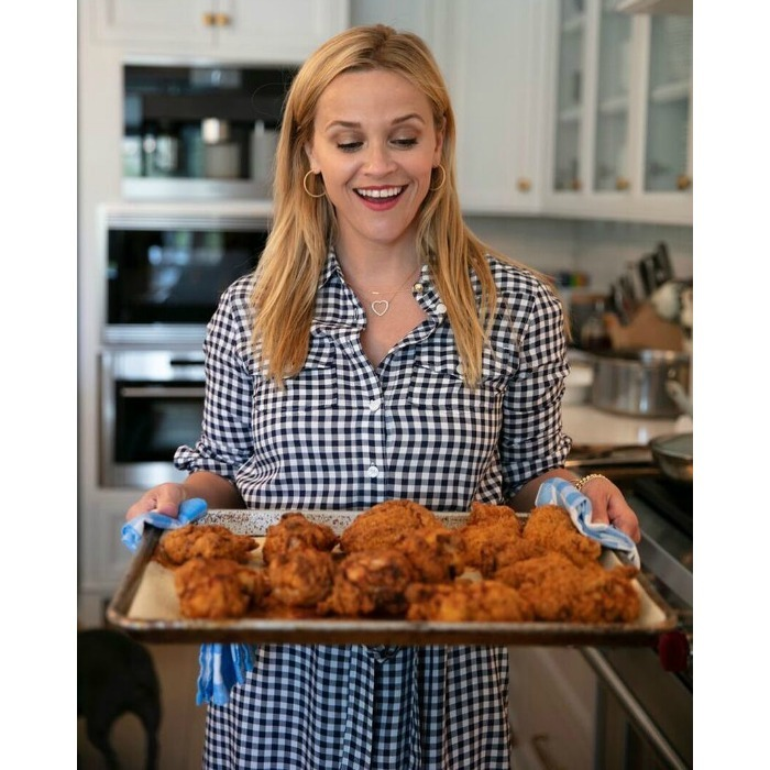 "Order up! It looks like Reese Witherspoon tapped into her grandma's recipes. ""Grandmother Dorothea created THE BEST fried chicken recipe,"" she wore on Instagram, ""and I'm so excited to finally share it with y'all in my upcoming book #WhiskeyInATeacup! #NationalFriedChickenDay""
