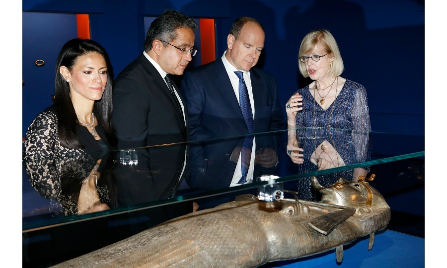 Walk like an Egyptian! Prince Albert II of Monaco got a close look at the Psusennes sarcophagus at Grimaldi Forum on July 6 in Monaco. Seen from left to right: Rania El Mashat, Ministry of Tourism of Egypt, SEM Khaled Elanany, Ministry of Antiquities of Egypt, the Prince and Christiane Ziegler, expertise of exhibition curator.