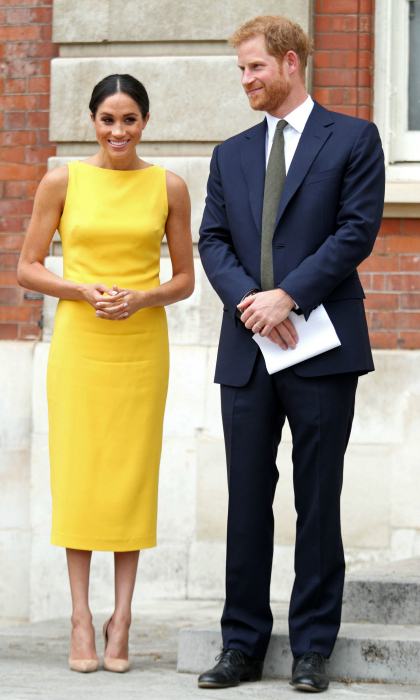 "The newly-minted Duchess of Sussex stepped out with her Duke wearing a chic yellow dress by American designer Brandon Maxwell for the Commonwealth Youth Forum reception on Thursday, July 5. Prince Harry's wife, who since saying ""I do"" had been favoring blushing tones, looked sunny in the now-sold out sleeveless boat-neck midi dress that originally retailed for $1,495.