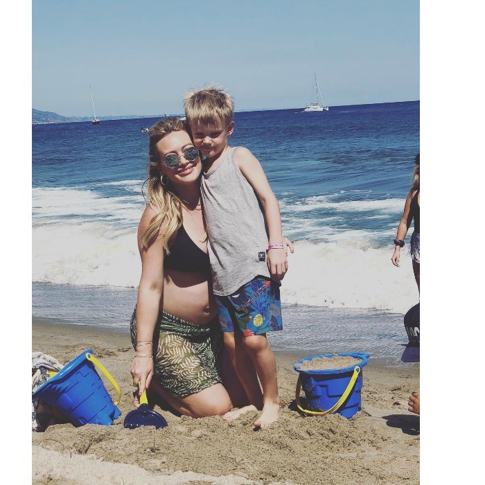 """Hilary Duff had a fun beach day with her six-year-old son Luca. Flaunting her baby bump, the actress shared a cute snap of her and Luca posing to Instagram, writing: """"My sweet sweet boy. Oh the adventures we've had."""" The pair seem to be enjoying their one-on-one time together before a new baby comes into the picture. Photo: Instagram/@hilaryduff"""