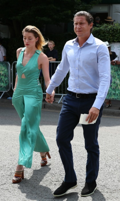 Amber Heard stepped out in style with her new man Vito Schnabel on day 7 of Wimbledon. The 32-year-old actress looked lovely in a mint green satin jumpsuit while her 31-year-old boyfriend kept things simple in a light blue shirt and navy pants.