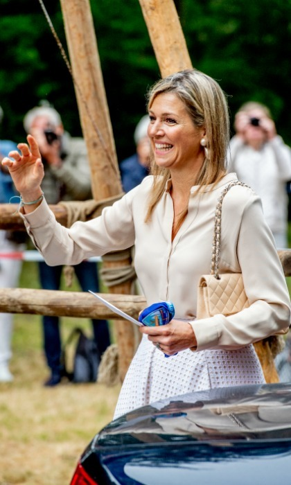 Scouts honor! Maxima received her own blue Scouts bandanna, showing it off as she warmly waved to her supporters.