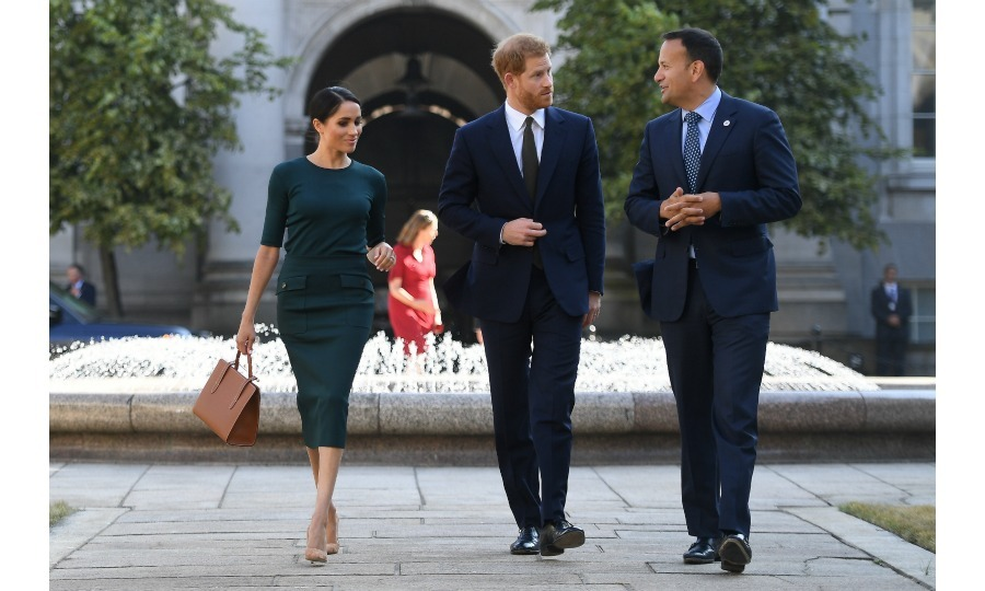 The happy couple walked along the scenic grounds of Dublin government buildings with politician Leo, who gave them a warm welcome.