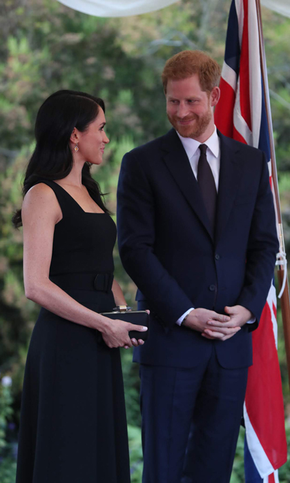 The Duke and Duchess had quite a busy Tuesday. For their third outing of the day, Meghan changed into a dress from one of Kate's go-to designers Emilia Wickstead. The royal changed her hair from her sleek bun to a wavy blowout with an extreme part. 