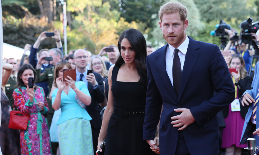 Harry and Meghan walked hand-in-hand into the garden party through a crowd that was eager to see them up close.