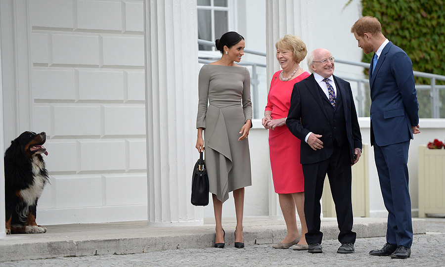 Duchess Meghan chose a form-fitting dress by her designer friend Roland Mouret to commence the second day of her whistle-stop tour of Ireland with husband Prince Harry on July 11. The chic, stone grey number featured her hallmark boatneck neckline and an elegant ruffle.