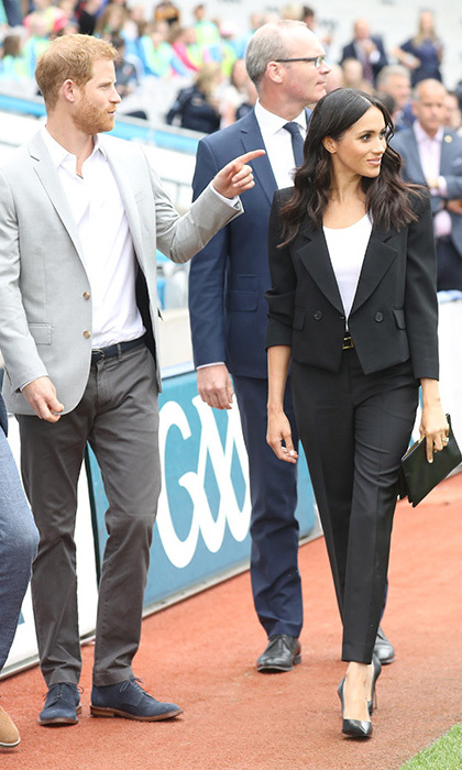 Meghan had the perfect business casual attire in Givenchy. The royal accessorized with Sarah Flint pumps and a clutch and kept her hair in loose waves.