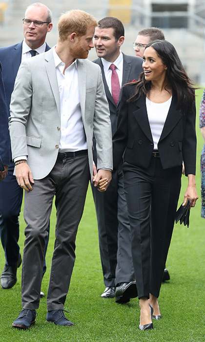 The couple had a sweet PDA moment when they held hands with one another while walking across the field at Croke Park. During their visit, the pair met players involved in community outreach projects and visited the museum, and looked to be in good spirits as they chatted to one another. 