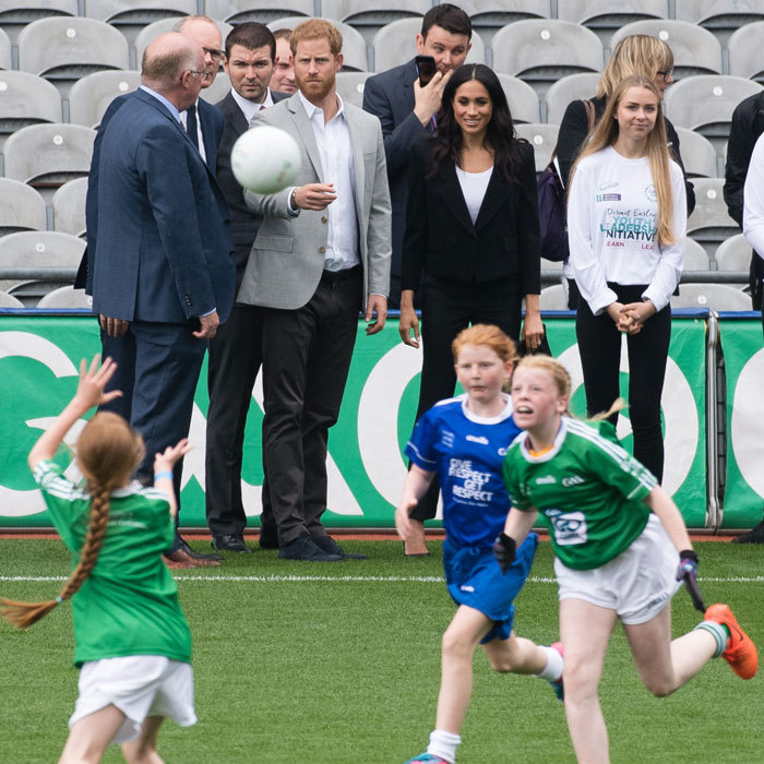 Avid soccer fan Prince Harry and Meghan, who seemed amused, watched a friendly competition during their visit.