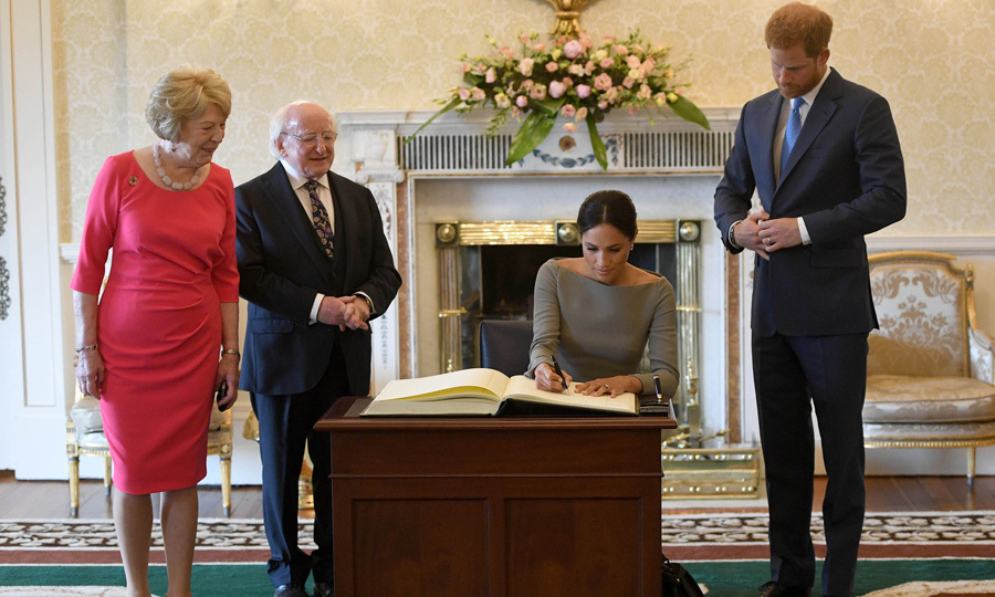 Prince Harry and Meghan signed the visitor's book. The Duchess let her husband go first and then she took her turn. They signed it Harry and Meghan.
