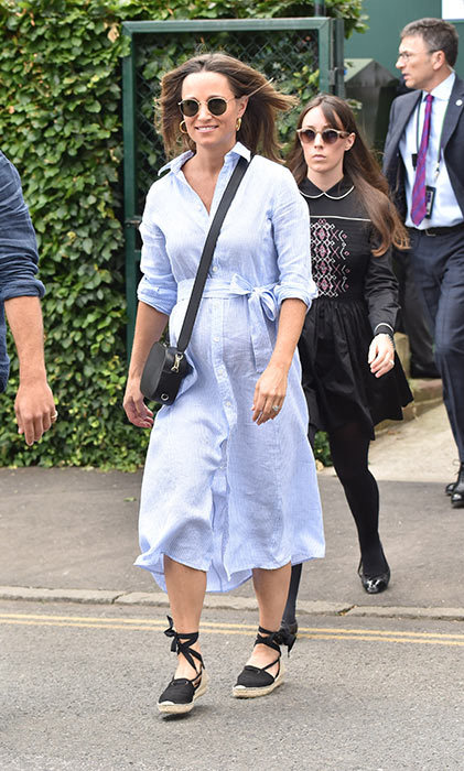 Pippa Middleton also attended Wimbledon on the 11th. She continued her maternity style streak in a casual blue-striped shirt dress. The mom-to-be joined her brother James to watch the quarter finals, both appearing in good spirits as they walked into the stadium.