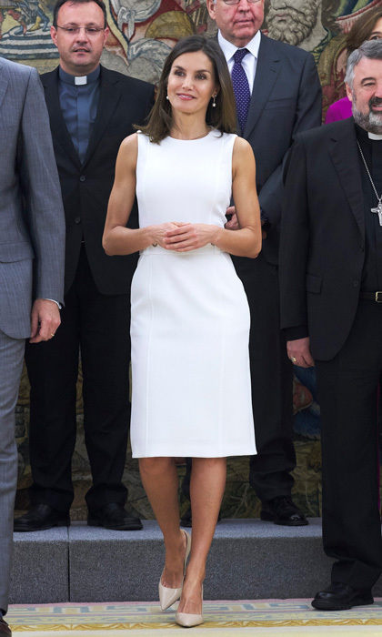 Queen Letizia showed off her toned arms in the perfect LWD by her go-to designer, BOSS, for an outing at Zarzuela Palace on July 10. King Felipe's wife accessorized the nautical-like frock with Prada pumps and pearl and diamond drop earrings. The sleeveless number highlighted the mom-of-two's toned arms and slim physique.