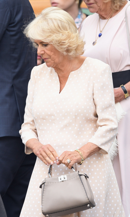 The Duchess of Cornwall had the perfect ensemble for her day at Wimbledon, watching Novak Djokovic play Japan's Kei Nishikori during the men's singles quarter-finals. Prince Charles' wife wore a blush quarter-sleeved dress with polka-dots. She accessorized with a gray Fendi peekaboo tote.