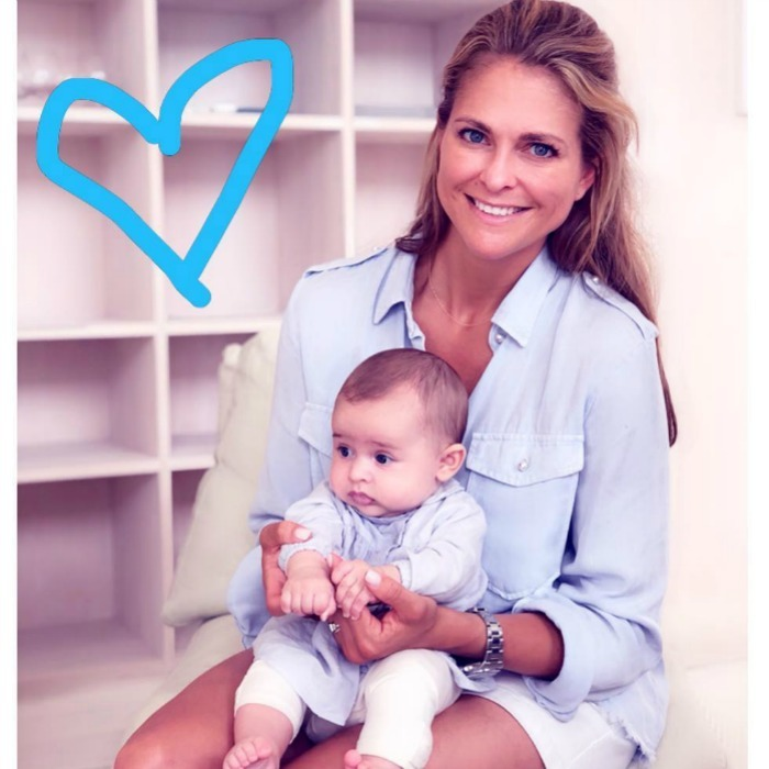 "Mommy-daughter matching! Princess Madeleine of Sweden shared a sweet summer moment with her baby Adrienne. ""4 month ago this little angel was born! We are so thankful for her,"" she wrote along with this photo of the duo wearing matching white and pale blue outfits.