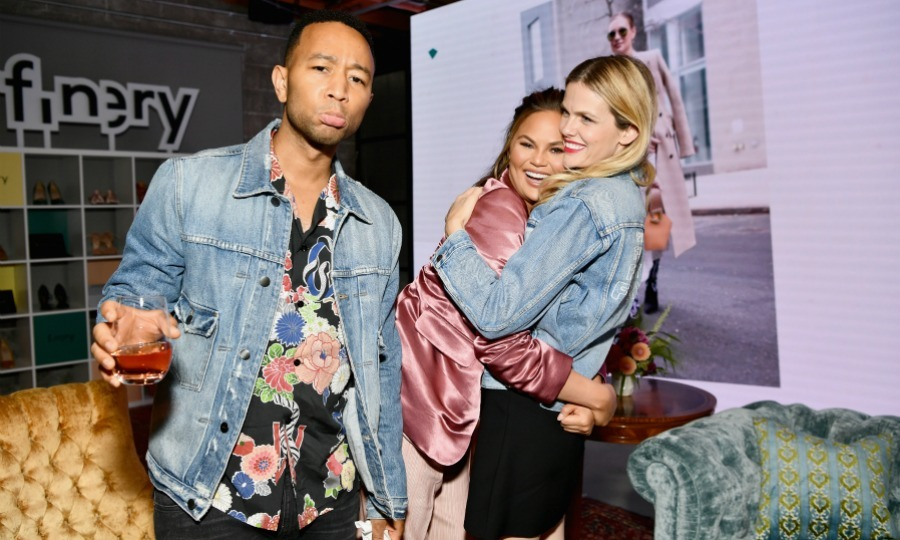 Who's the third wheel? John Legend played sad when Chrissy Teigen opted to show some love to the other person in the jean jacket: Brooklyn Decker! The actress co-founded Finery, hosting the app's launch party at Microsoft Lounge on July 11 in Culver City, California. 