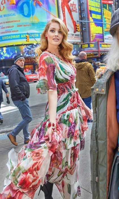 "Drenched in Dolce, Kitty kicked off June by wearing the designer's flowy frock on the streets of NYC. ""Over the moon to be to be in @voguebrasil wearing @dolcegabbana,"" she wrote. 