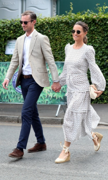 Pippa Middleton and James Matthews returned on day 11 of the Championships. The 34-year-old younger sister of the Duchess of Cambridge looked delightful in a light, long-sleeved dress. With her baby bump out on display, she walked in with her equally stylish 42-year-old former race car driver husband.
