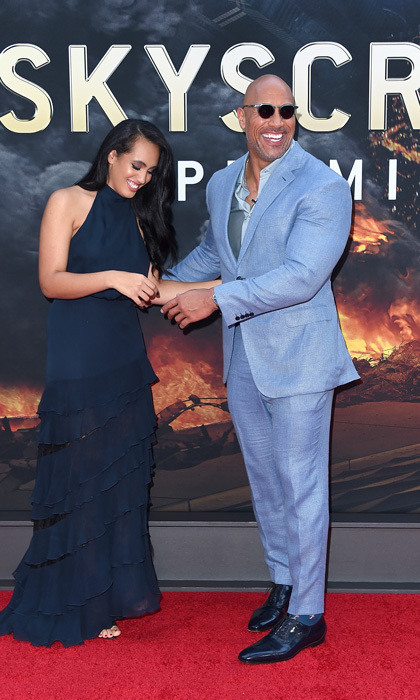 Dwayne Johnson had a special date with him at the <i>Skyscraper</i> premiere in NYC. The former WWE star was accompanied by his daughter Simone, who recently said she would love to follow in her dad's footsteps into the ring.