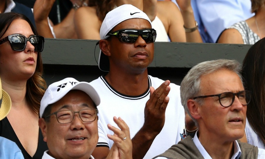 Going incognito in a hat and shades, Tiger Woods was also spotted in the star-studded stands on day 12.