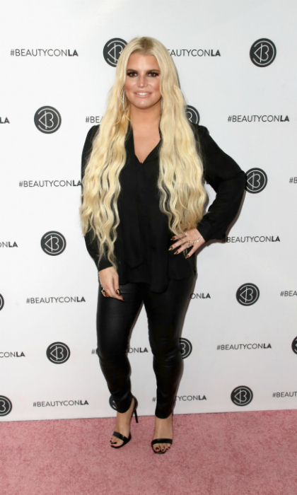Strike a pose! Jessica Simpson also stepped out for Beautycon L.A. The 38-year-old fashion designer looked sleek in a black top, black leather pants and heels as she walked the carpet.