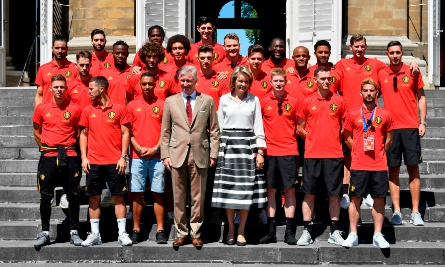 Team photo! Belgium's King and Queen posed for a picture with their nation's team players at the Royal castle in Laeken.