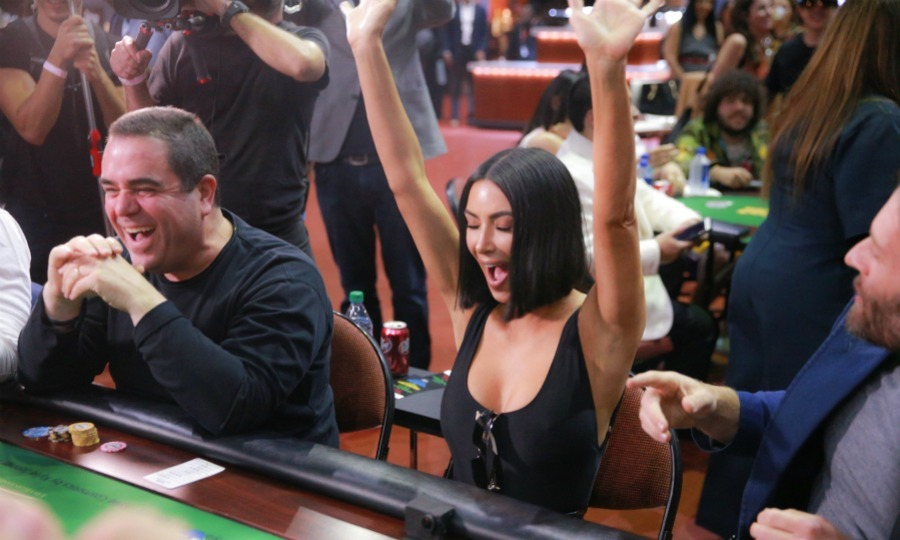 Kim did a victory cheer at one point, throwing up her own hands to celebrate a winning hand!