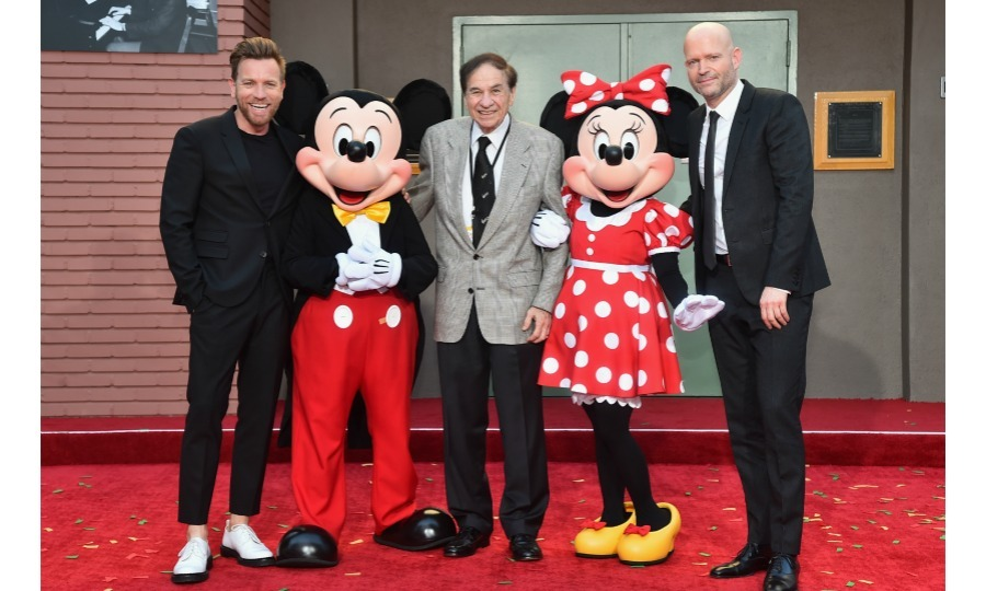 Ewan McGregor posed with an iconic bunch! The star caught up with legendary songwriter Richard M. Sherman  and the director of his new film <i>Christopher Robin</i> Marc Forster at the dedication and re-naming of the historic Orchestra Stage, now the Sherman Brothers Stage A, on the Disney Burbank lot. They were, of course, joined by Mickey and Minnie themselves ahead of the world premiere of the new Disney flick on July 30.