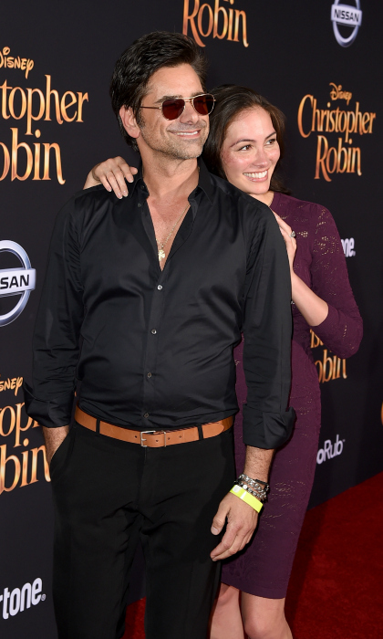 Prom pose! John Stamos and his lady love Caitlin McHugh attended the premiere of Disney's <i>Christopher Robin</i> at Walt Disney Studios on July 30 in Burbank, California. 