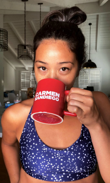 Where in the world is... Gina Rodriguez? Days after setting off speculation of an engagement to her longtime boyfriend, the <i>Jane the Virgin</i> star posted a ringless snap to her Instagram story. Although the photo may have answered the question of engagement, the mug she casually sipped sparked a whole other one: did her new <i>Carmen Sandiego</i> Netflix series start filming?
