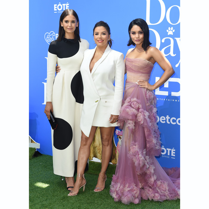 Eva Longoria made a stylish return to the red carpet with her <i>Dog Days</i> co-stars Nina Dobrev and Vanessa Hudgens. This was the first public outing for the new mom, who welcomed Santiago Enrique Baston on June 19.