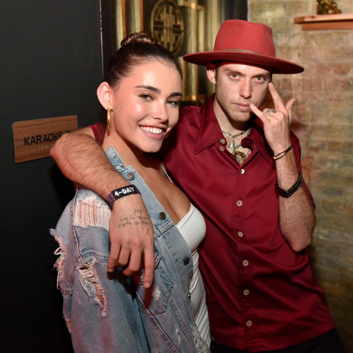 Madison Beer and Harry Hudson posed together before snacking on light bites from McDonald's at the Blind Dragon opening inside FOUND hotel in Chicago.