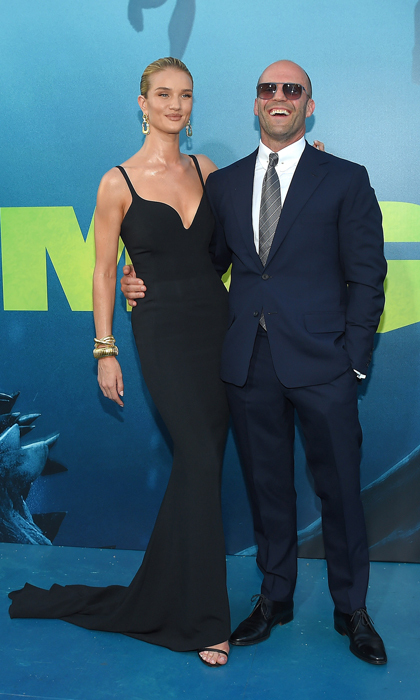 The couple was able to enjoy their parents' night out on the L.A. carpet for <i>The Meg</i>. For the occasion, Rosie stunned in a figure-hugging black Stella McCartney gown with 18 karat gold David Webb diamond Plaza earrings while her love accessorized his suit with sunglasses and a smile.
