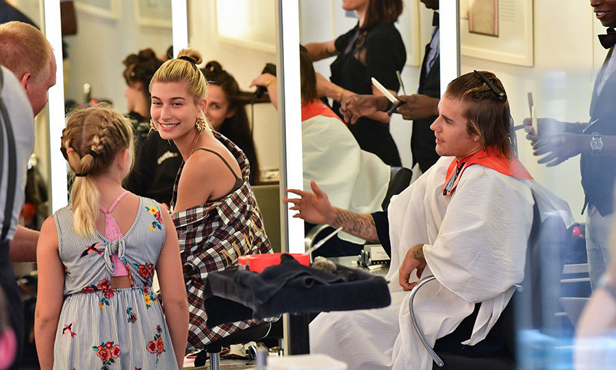 "Hailey Baldwin took Justin Bieber to her go-to salon in NYC for a haircut. The supermodel endearingly watched her fiancé get a trim by Armond at Cutler Salon. ""I had the amazing pleasure to cut the super TALENTED Justin Bieber's hair today (JUST A TRIM, HE WANTED TO KEEP IT LONG) ! He's such an amazing guy and super nice,"" Armand wrote on Instagram. ""Thank you to Ryan Pearl @ryanpearl23 for the wonderful referral.""