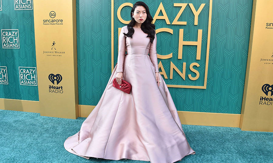 Hot on the heels of her promo tour for <i>Ocean's 8</i>, Awkwafina was dressed to impress in a show-stopping pink Reem Acra gown on the <i>Crazy Rich Asians</i> carpet. 