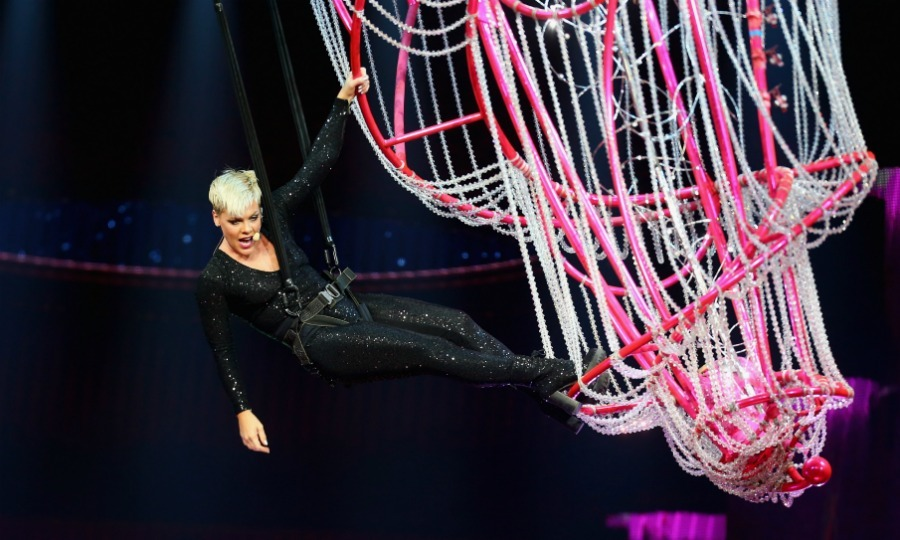 "After being ""rushed to the hospital in excruciating pain"" and forced to cancel shows, Pink made a triumphant return back to her tour on Saturday, August 11 in Sydney, Australia. The 38-year-old superstar fearlessly resumed her <i>Beautiful Trauma</i> show at the Qudos Bank Arena, soaring over her fans with her signature aerial stunts and killer vocals.