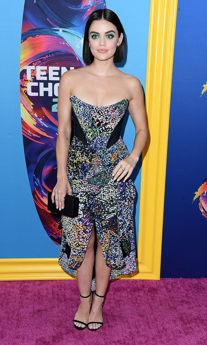 "Lucy Hale's electrifying green eyeshadow complemented her multi-colored strapless dress for the Teen Choice Awards. The <i>Pretty Little Liars</i> star wrote on Instagram with a close-up: ""Poison Ivy, we WENT for it tonight."" The bright look was done by Kelsey Deenihan. 