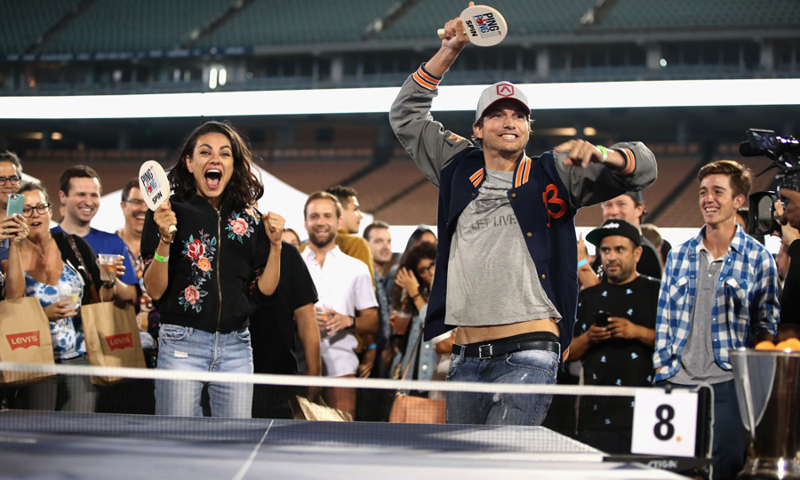 Teamwork makes the dream work! Ashton Kutcher and Mila Kunis showed their competitive sides during Clayton Kershaw's charity ping pong tournament at Dodgers Stadium. 