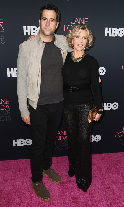 Jane Fonda showed off her true style sense in sequined pants for the premiere of her new documentary <i>Jane Fonda in Five Acts</i> coming to HBO. The 80-year-old posed with her son Troy Garity, whose dad is Tom Hayden, on the pink carpet in L.A.