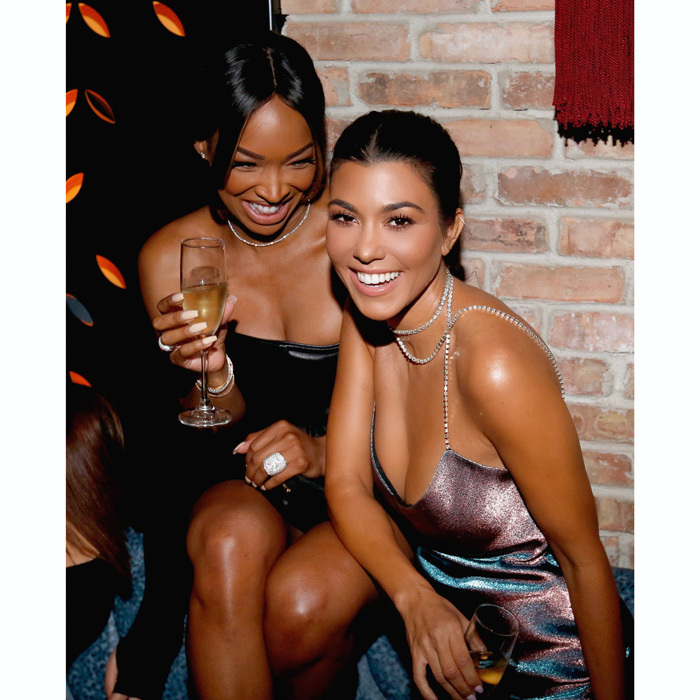 Kourtney Kardashian and Malika Haqq had a quick getaway to Chicago for Tao's opening over the weekend. The duo danced atop their private booth overlooking the rest of the nightclub while sipping on champagne. The newly single <i>Keeping Up with the Kardashians</i> star also continued the party with 20-year-old Luka Sabbat at the FOUND hotel opening.