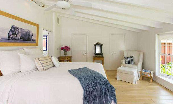 This bedroom is kept light-and-airy with white walls, large windows and simply chic decorative molding. (Image: MLS)