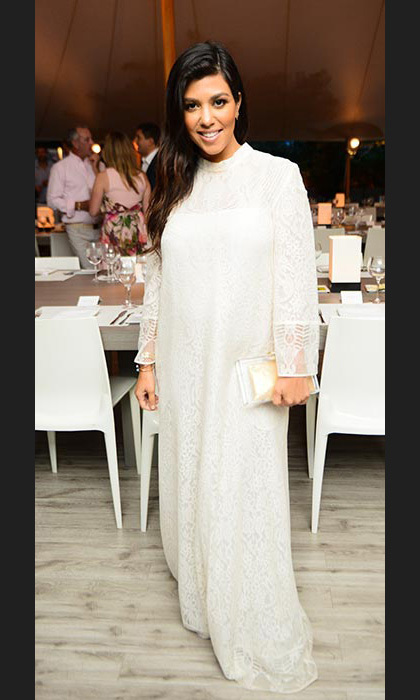 Wowing in a white long-sleeved maxi dress for a summer dinner in New York.